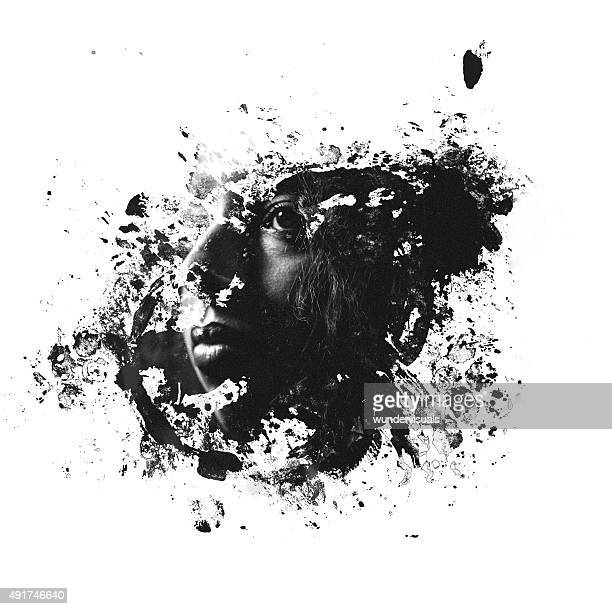 Double exposure image of woman's face within a splatter form
