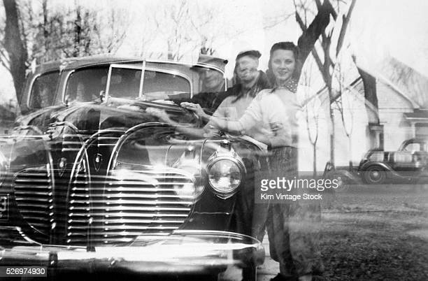 Double exposure of a couple and their car ca 1940