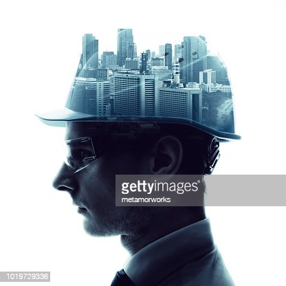 Double exposure of a engineer and urban cityscape. : Stock Photo