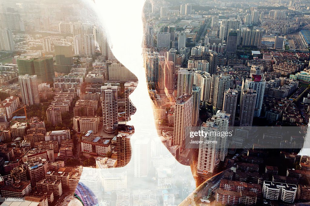 double exposure of a man,woman and cityscape : Stock Photo