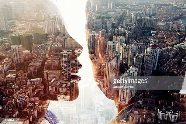 double exposure of a man,woman and cityscape