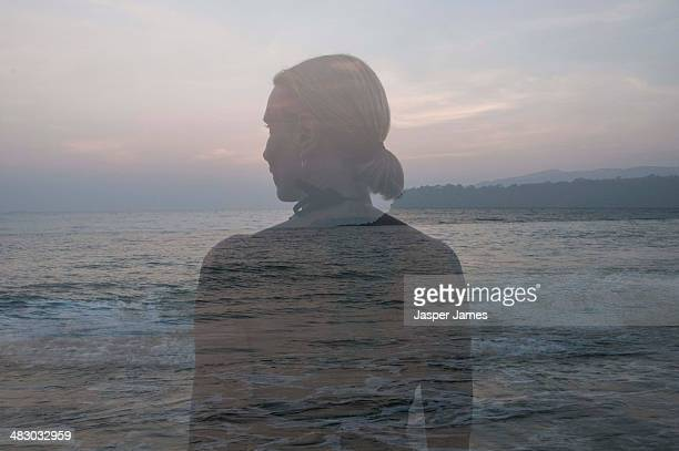 double exposure of a woman looking out to sea