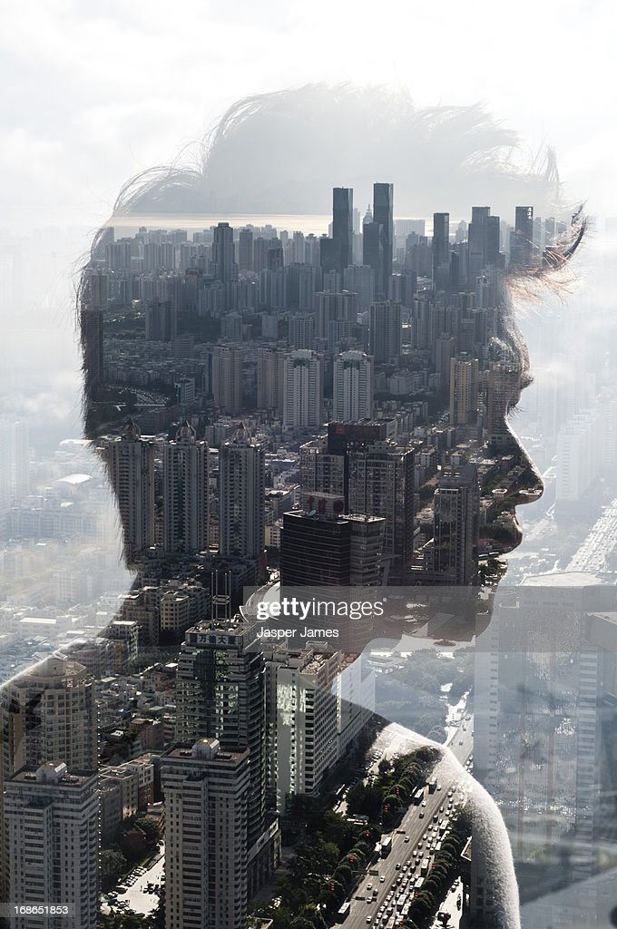 double exposure of a young man and cityscape : Stock Photo
