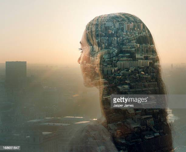 double exposure of a young woman and cityscape