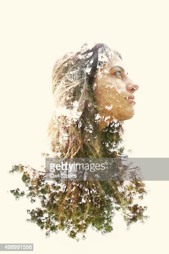Double exposure of a young woman and trees  Stock Photo