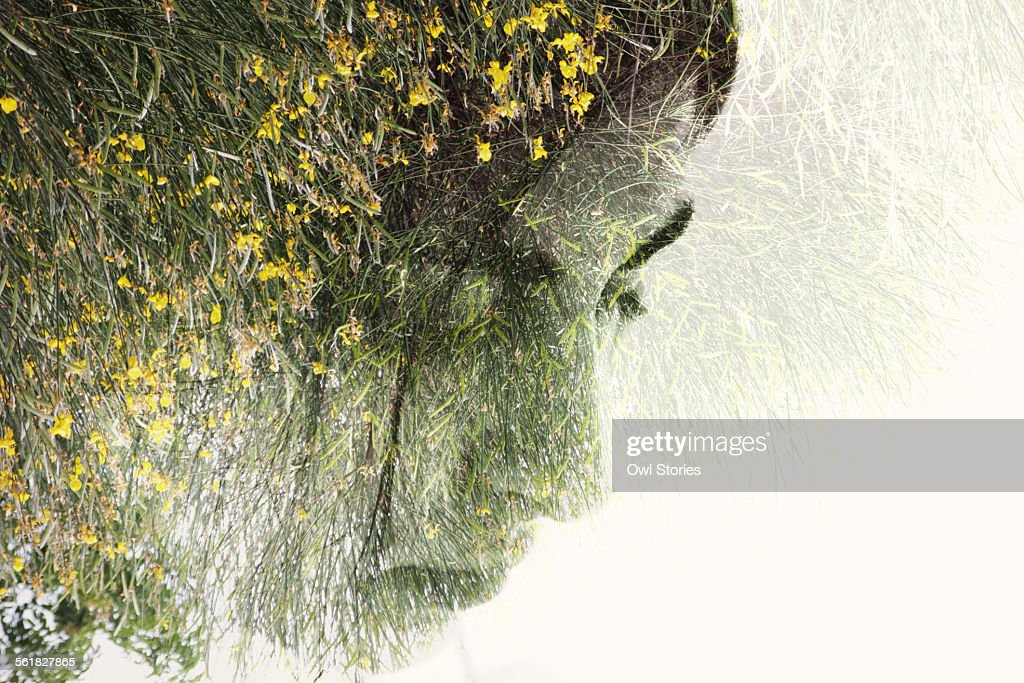 Double exposure of a young woman's face & flowers