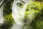 Double exposure of beautiful girl and green leaves