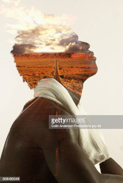 Double exposure of Black man and rural landscape