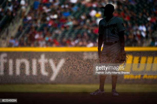 A double exposure of Brandon Phillips of the Atlanta Braves in the field against the Milwaukee Brewers at SunTrust Park on June 24 2017 in Atlanta...