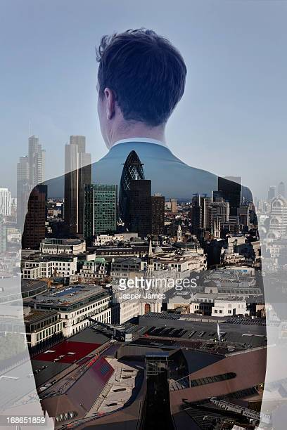double exposure of business man and cityscape