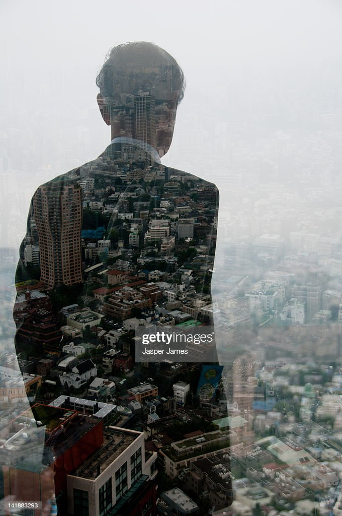 Double exposure of business man looking out of win : Stock Photo