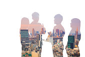 Double exposure of business team and urban cityscape.