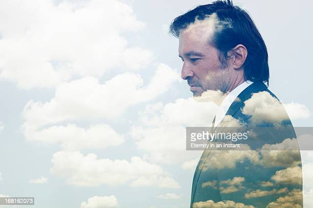 double exposure of businessman and clouds