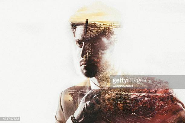 Double exposure of businessman and port city with subtle colour