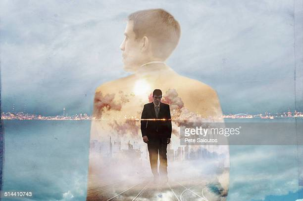 Double exposure of businessman and urban coastline