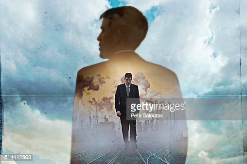 Double exposure of businessman in clouds