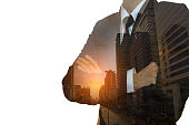 Double exposure of businessman in suit and cityscape