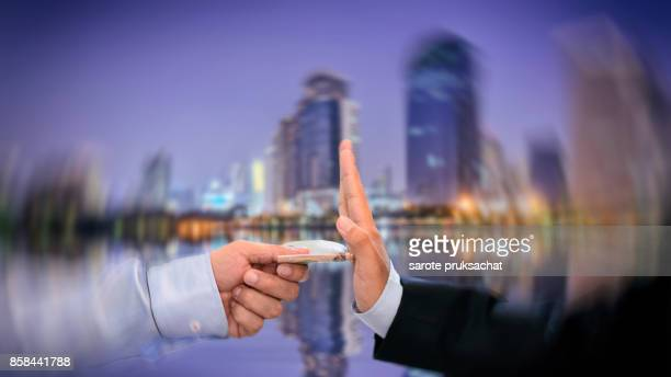 Double exposure of Businessman refusing to take bribe. Corruption concept