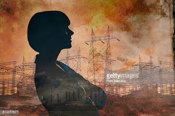 Double exposure of businesswoman and power lines
