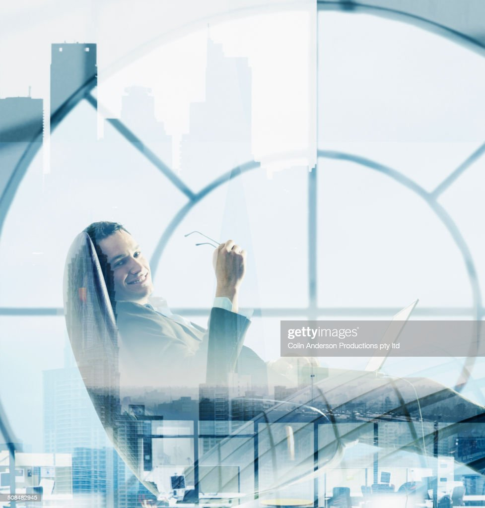 Double exposure of Caucasian businessman and cityscape