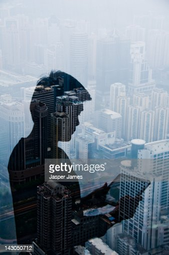 double exposure of cityscape and man : Stock Photo