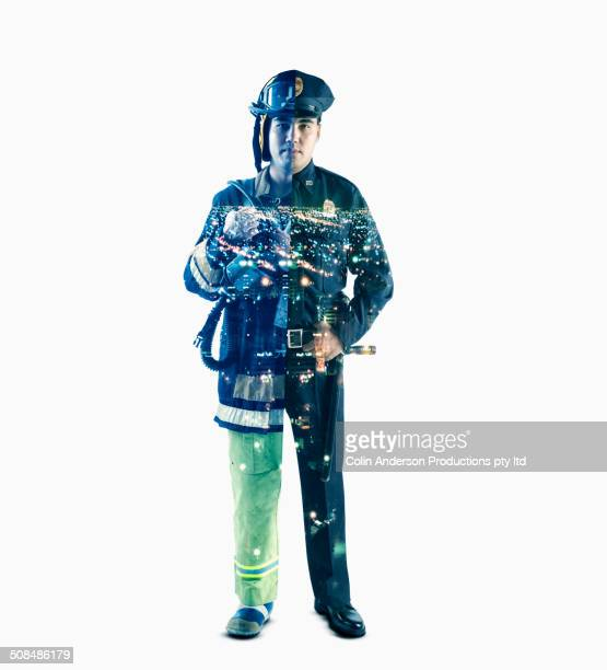 Double exposure of cityscape, fire fighter and police officer