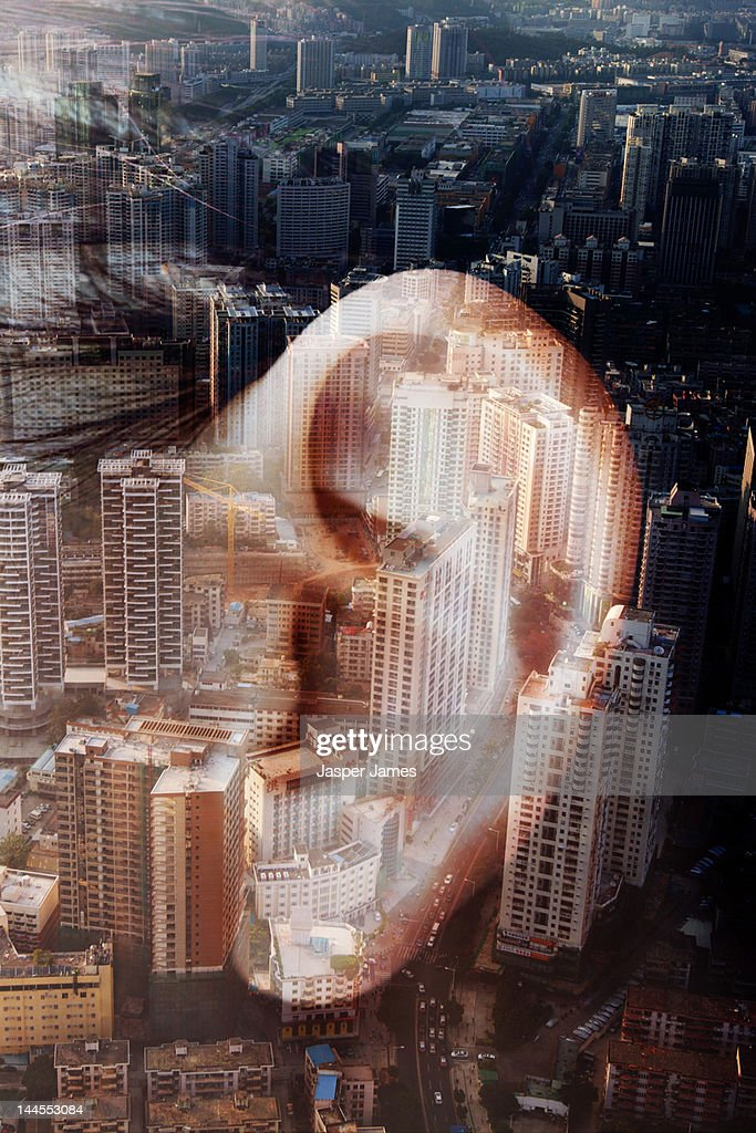 double exposure of ear and cityscape