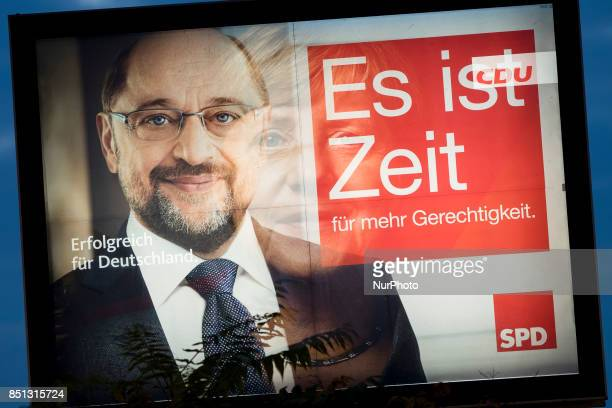 Double exposure of election posters showing chancellor candidate of the Social Democratic Party Martin Schulz and German Chancellor Angela Merkel in...