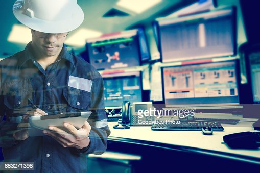 Double exposure of  Engineer or Technician man in working shirt  working with tablet in control room of oil and gas platform or plant industrial for monitor process, business and industry concept : Stock Photo