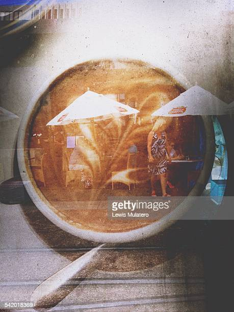 Double exposure of flat white coffee on cafe table and woman leaving cafe