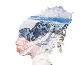 Double exposure of girl with braids profile portrait and mountainscape