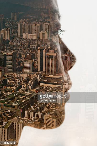 double exposure of girls face and cityscape