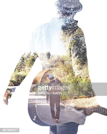 Double Exposure Of Guitarist And Trees On White Background