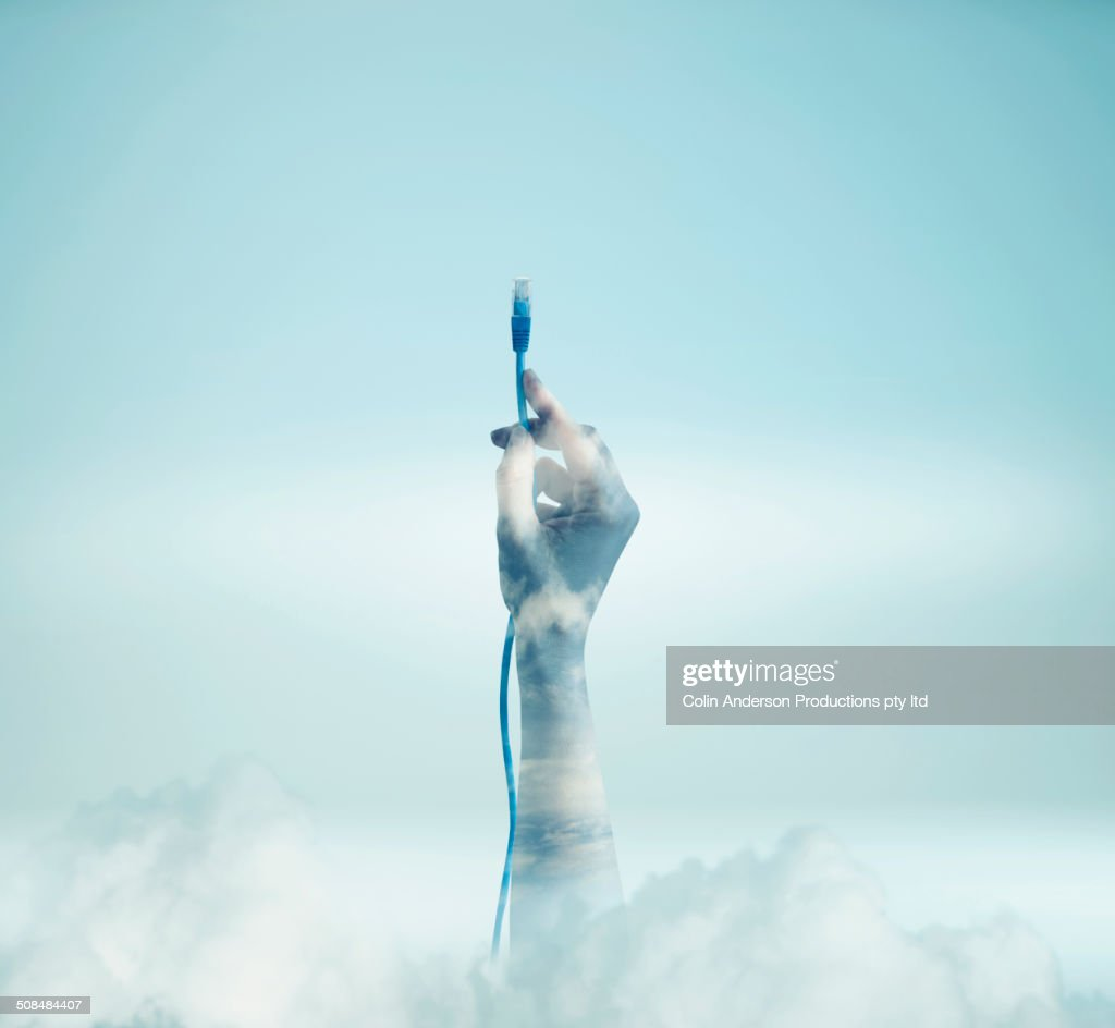 Double exposure of hand holding cord in clouds