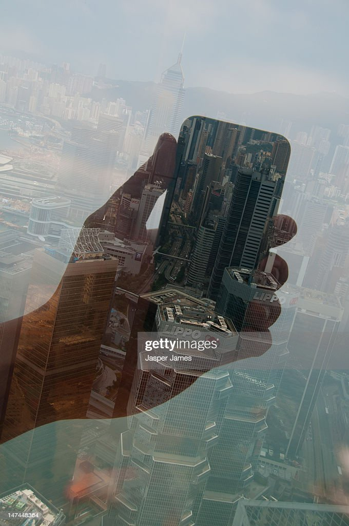 double exposure of hand holding mobile phone : Stock Photo