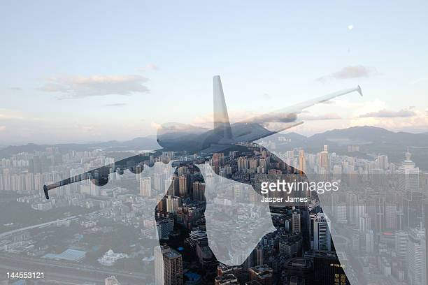 double exposure of hand holding toy airplane