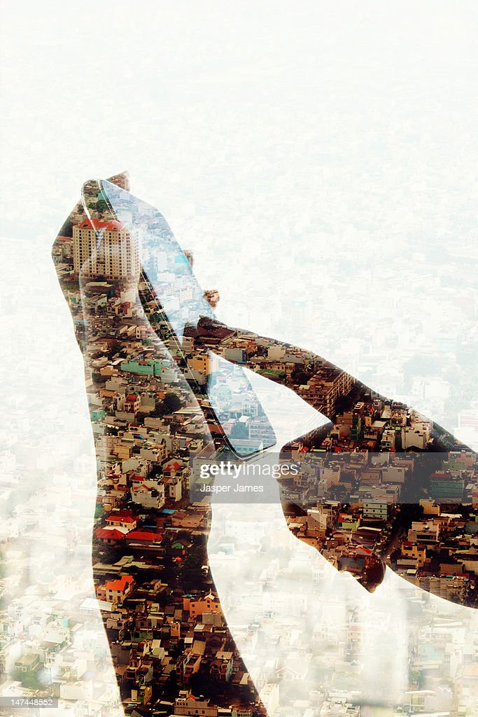 double exposure of hand with mobile phone : Stock Photo