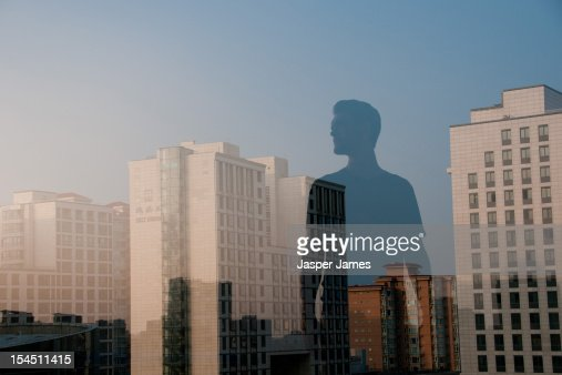double exposure of man and cityscape : Stock Photo