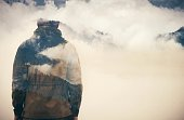 Double Exposure of Man and Cloudy Mountains forest Travel Lifestyle conceptual background