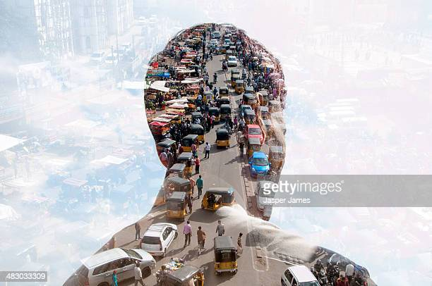 double exposure of man and Indian cityscape