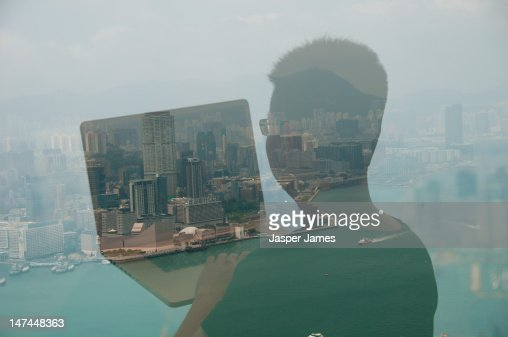 double exposure of man and lap top : Stock Photo