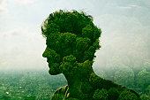 double exposure of man and trees