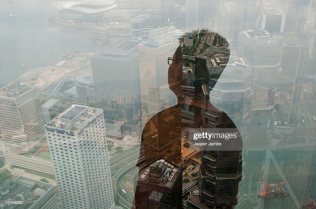 double exposure of man at window : Stock Photo