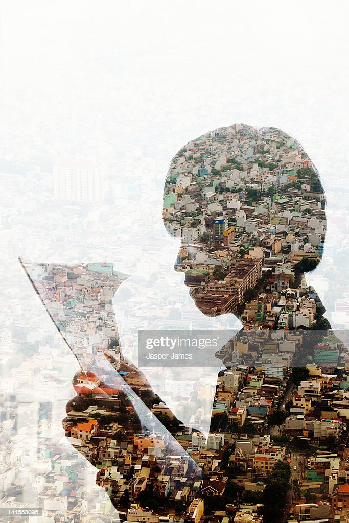 double exposure of man reading newspaper