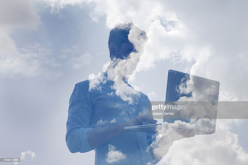 double exposure of man using laptop and sky : Stock Photo