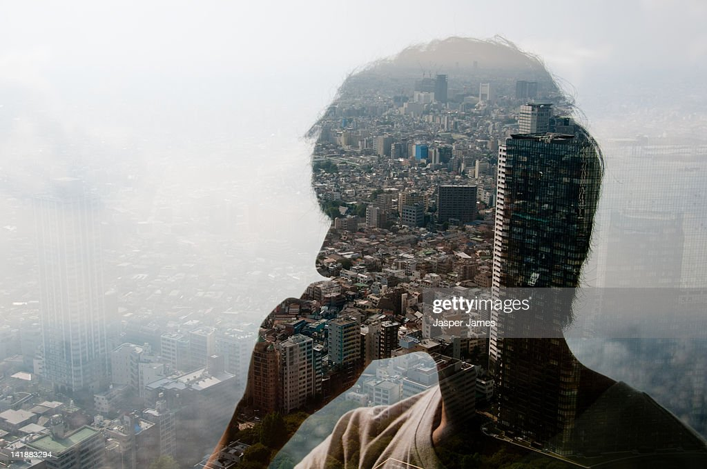 double exposure of man using phone and cityscape : Stock Photo