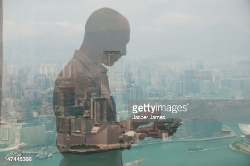 double exposure of man using phone and Hong Kong : Stock Photo