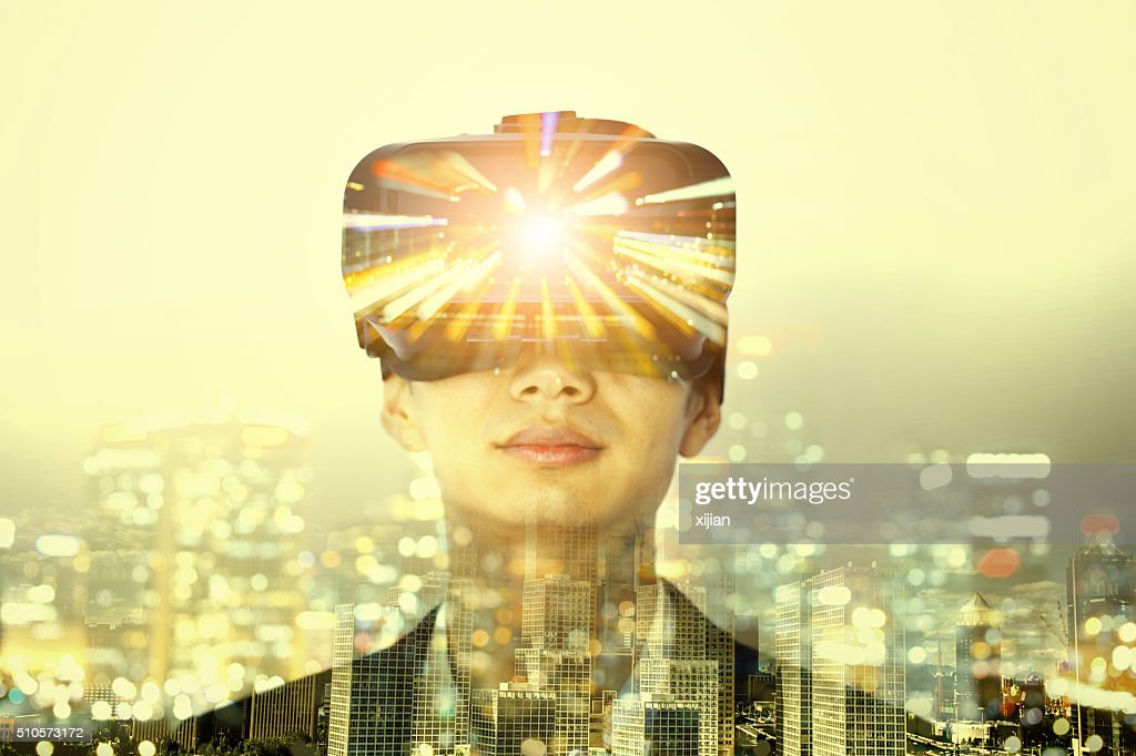 Double exposure of man wearing virtual reality headset : Stock Photo