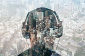 double exposure of man with headphones and citysca
