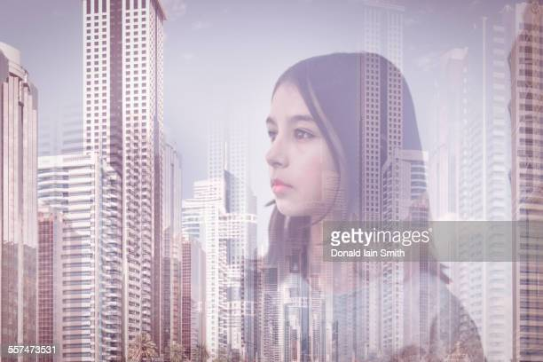 Double exposure of mixed race girl over Palmerston North cityscape, Manawatu, New Zealand